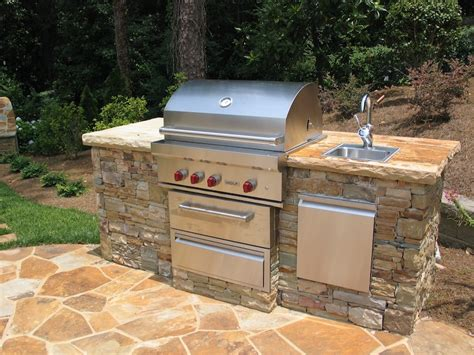 kitchen island sink on pinterest outdoor kitchen design stacked stone grilling station with sink 2 outdoor