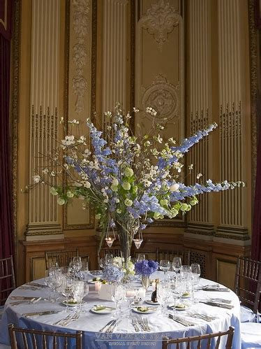 tall wedding centerpieces with white, green and purple