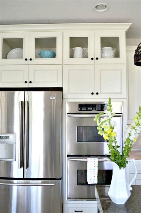 how to shop for kitchen cabinets how to add glass inserts into your kitchen cabinets