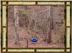 hanging a swing between two trees tire swings