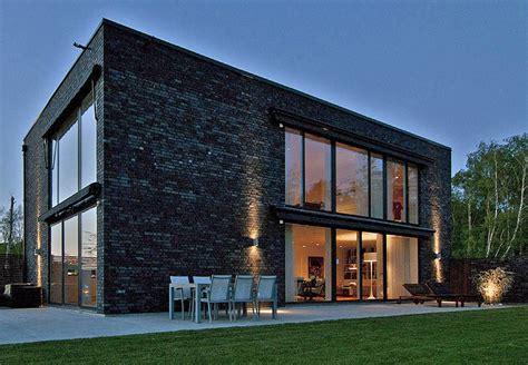 black brick villa with chic scandinavian charm