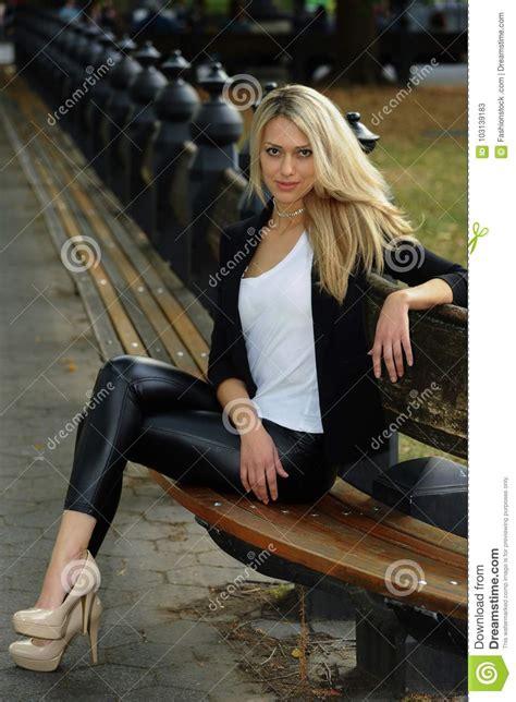 posing bench fashion glamour model posing on the bench stock image