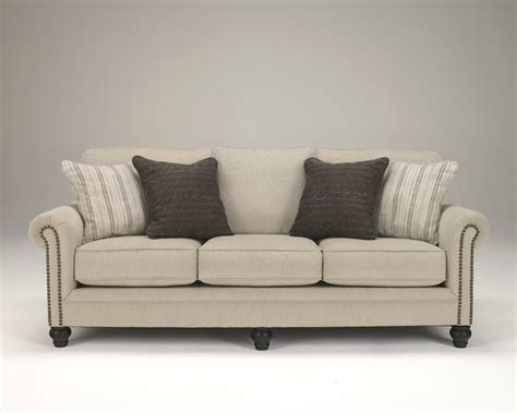 fabric sofa with nailhead trim ashley 1300038 milari linen fabric upholstery sofa with