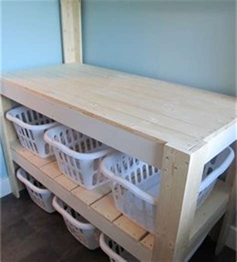 diy laundry room table 25 best ideas about laundry folding station on laundry basket storage utility room