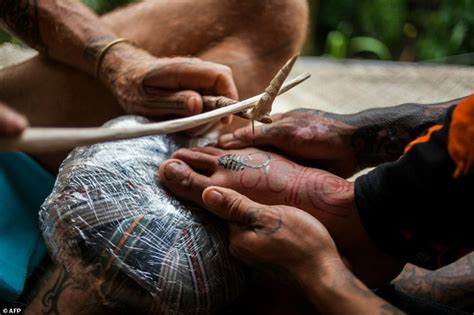 hand tapped tattoo tattooists revive tribal traditions of