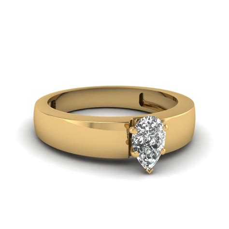 flat solitaire pear shaped engagement ring in 14k yellow