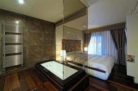 Glass partition wall design ideas and room iders separating modern bedrooms from bathrooms