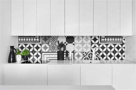 geometric pattern kitchen tiles posh monochromatic apartment by widawscy studio architektury