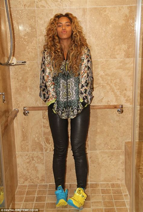 Shower Clothes by Beyonce Strikes A Sultry Pose In The Shower But Leaves Clothes And Trainers On Daily Mail