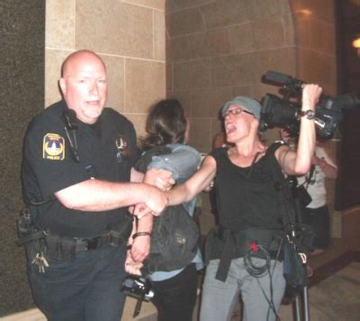 two reporters taken into police custody at protest against