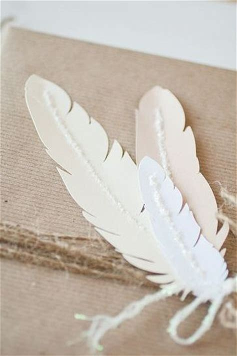 Paper Feathers - pretty white paper feathers on brown kraft paper gift wrap