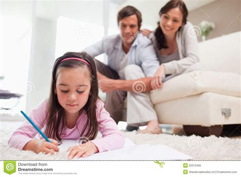 Mother Daughter House Plans little girl drawing with her parents in the background