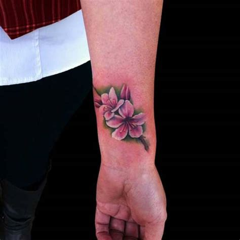 cherry blossom wrist tattoo 34 awesome wrist flower tattoos
