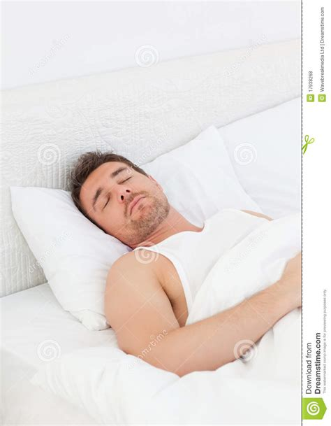 man in bed a man in his bed before waking up royalty free stock