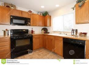 Kitchen Cabinets With Black Appliances Brown Kitchen Cabinets With Black Appliances Stock Photography Image 38418552