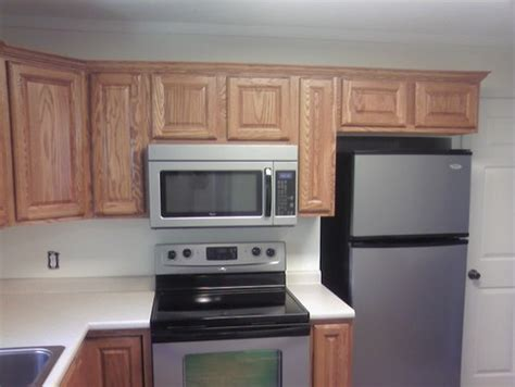 microwave above stove what is the suggested height of a microwave the stove