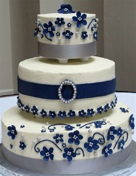 Gold Cake Choco Cheese three tiers with two different types of cake white chocolate cheese buttercream flowers