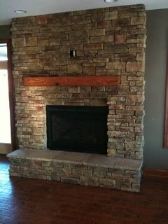 Fireplace Mantels Kansas City rustic oak cabinetry with reclaimed barn beam accents rustic fireplace mantels kansas city