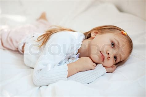 portrait of child lying in bed stock photo colourbox