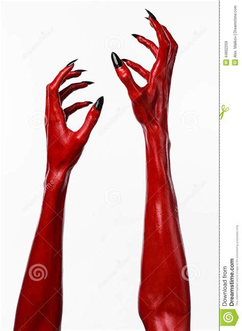 red devils hands  black nails red hands  satan