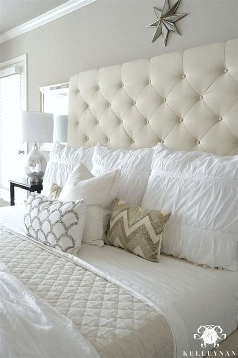 White Quilted Headboard Bed by Master Bedroom Update Ottomans Pottery And The