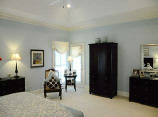 traditional guest bedroom with high ceiling ceiling fan