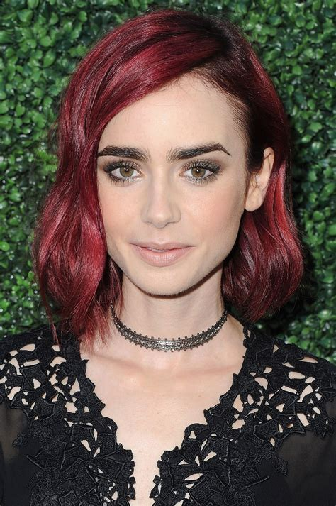 actress with bright red hair lily collins debuts new red hair beauty crew