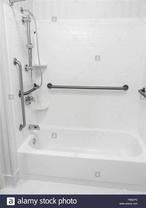 handicapped disabled access bathroom bathtub shower  grab bars stock photo  alamy