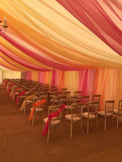 marquee drapes coloured drapes yellow orange redsa and creams