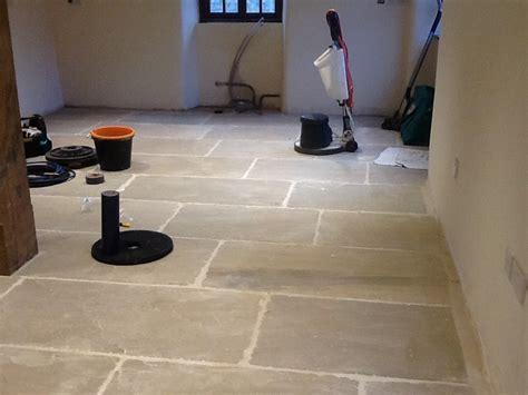 removing grout left from sandstone after tiling