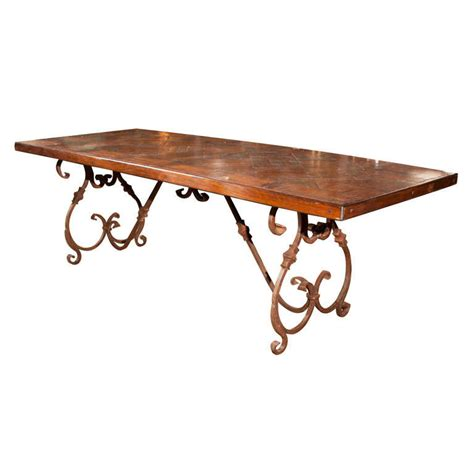 wrought iron wood dining table wrought iron base wood top dining table at 1stdibs
