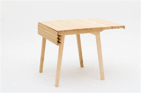 Designer Tables by Ingenious Folding Table Inspired By A Caterpillar S Track