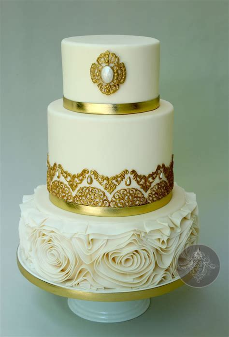Gold Themed Cake | golden wedding cake with floral ruffles this is a gold
