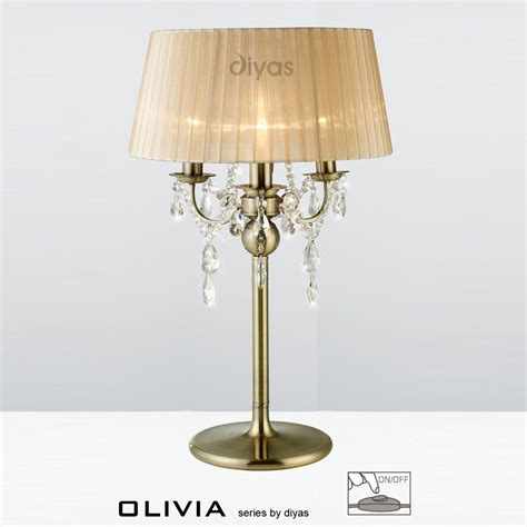 3 light table l diyas il30065 sb 3 light antique brass table l