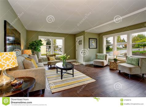 well decorated homes lovely living room with green and yellow theme stock