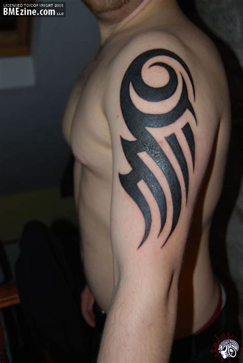 tribal bicep tattoos for guys index of images 49
