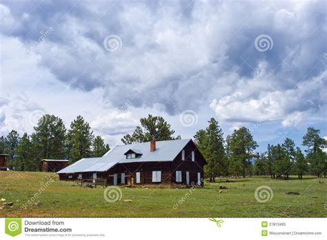 rustic mountain cabin ranch clouds stock