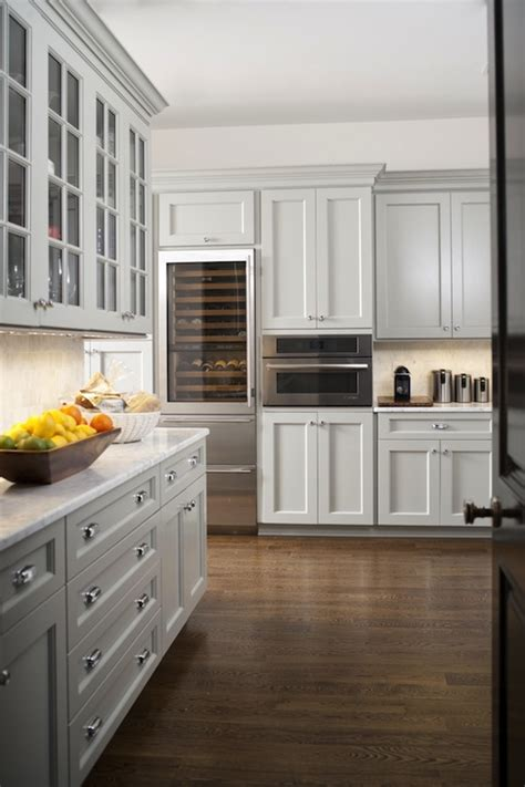 light gray kitchen cabinets with white countertops glass front wine fridge design ideas