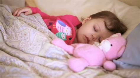 baby sleeping in bed with parents a baby sleeping in a cradle stock footage video 4801652