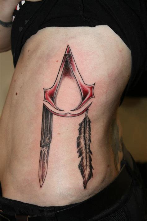 tattoo assassins ac assassins creed tattoo on side rib by kimiko28