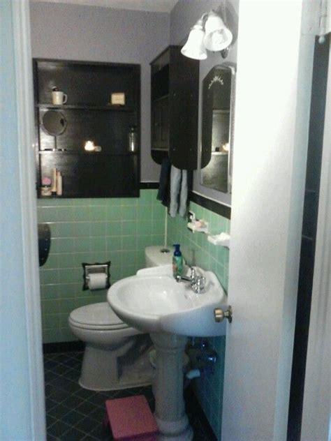 Mint green tiled bathroom painted tile elegant vintage