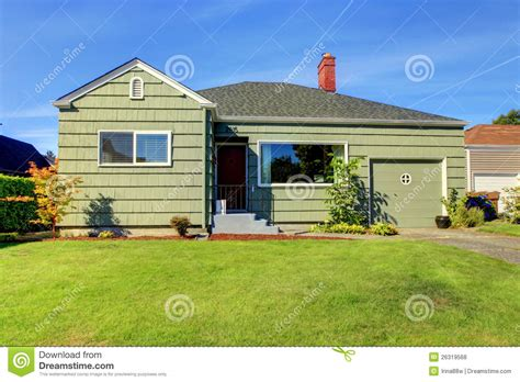 garage door tiny house green small green house with garage door royalty free