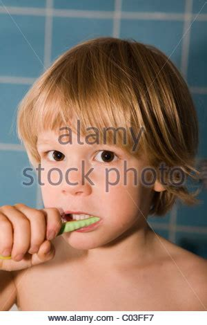 hairbrush for boy 4yr old four year old boy brushes his teeth stock photo royalty