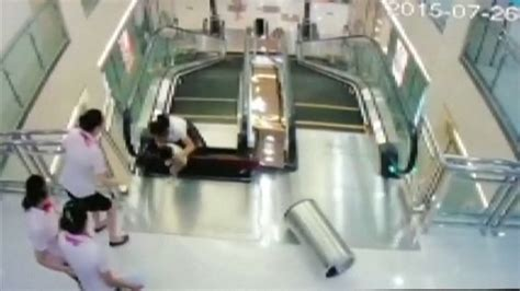 crushed by escalator chinese mother saves her child s life seconds before she
