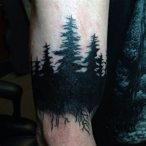 pine tree wrist tattoo of pine tree forest on black and gray tattoos