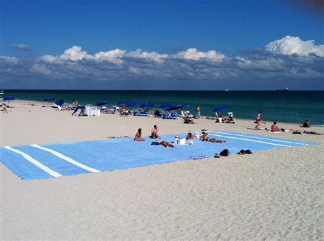 largest beach in the world world s biggest beach towel a social experiment by miami