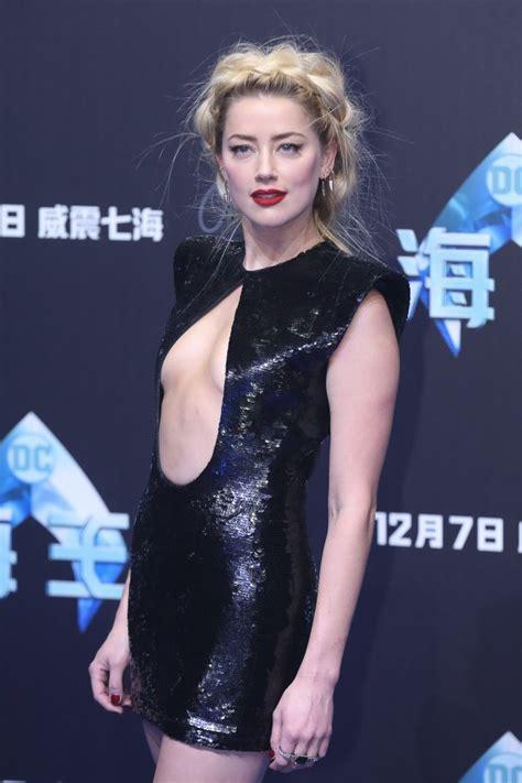 actress in aquaman 2018 amber heard rocks daring cut out mini dress at aquaman