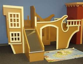 boy and bunk beds pirate ship indoor playhouse simple playhouse with slide