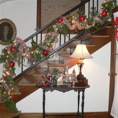 decorate a stair rail with mesh ribbon mesh