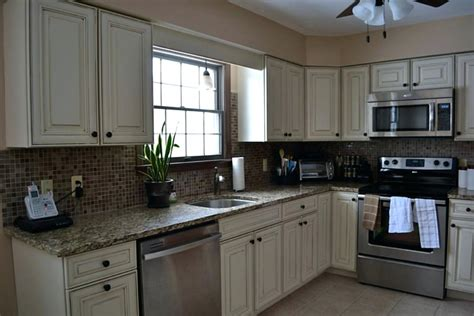 white cabinets with stainless appliances playableartdc co